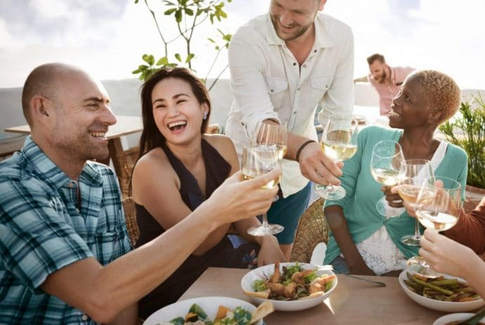 Outdoor group enjoying food and wine
